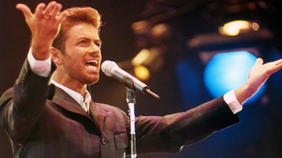 """In this Dec. 2, 1993 file photo, George Michael performs at """"Concert of Hope"""" to mark World AIDS Day at London's Wembley Arena.  (AP Photo/Gill Allen)"""