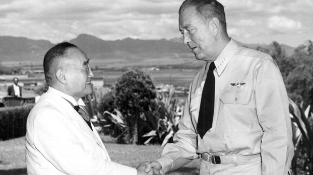 In this Sept. 12, 1951 photo provided by the U.S. Navy, Japanese Prime Minister Shigeru Yoshida, left, shakes hands with Adm. Arthur Radford, commander of the U.S. Pacific Fleet, at Radford's headquarters overlooking Pearl Harbor in Hawaii. (U.S. Navy via AP)