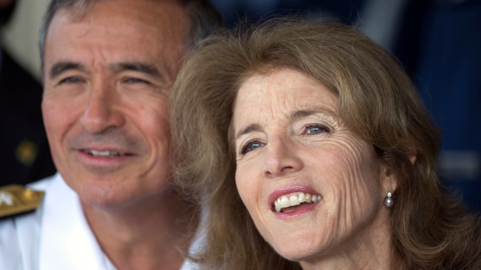 U.S. Adm. Harry Harris, United States Pacific Command, left, and Caroline Kennedy, U.S. Ambassador to Japan, watch Japan's Prime Minister Shinzo Abe arrive at Joint Base Pearl Harbor Hickam, Monday, Dec. 26, 2016, in Honolulu. (AP/Marco Garcia)