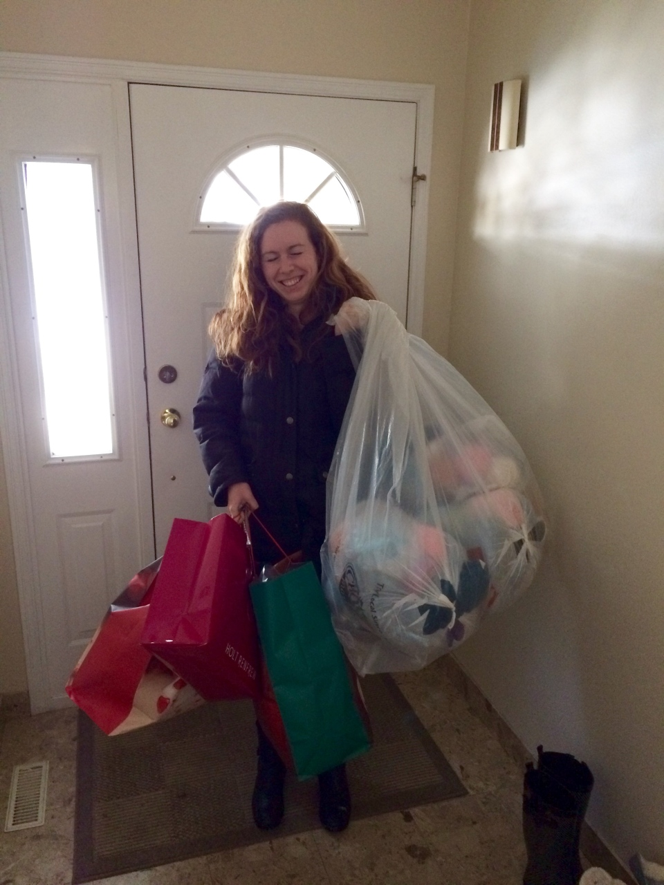 CTV Vancouver's Katelyn Verstraten imitates Santa as she arrives with the yarn donations. (CTV News). Dec. 26, 2016.