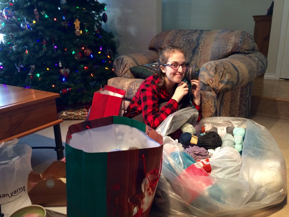 Catherine Richardson sorts out the donations in her Port Moody, B.C. home. (CTV News). Dec. 26, 2016.
