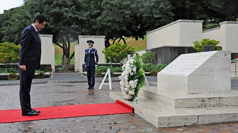 Japanese Prime Minister Shinzo Abe visits the National Memorial Cemetery of the Pacific to place a wreath at the Honolulu Memorial, Monday, Dec. 26, 2016, in Honolulu. He stood for a moment of silence after the wreath laying. (Bruce Asato /The Star-Advertiser via AP)