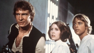 "In this 1977 image provided by 20th Century-Fox Film Corporation, from left, Harrison Ford, Carrie Fisher, and Mark Hamill are shown in a scene from ""Star Wars"" movie, released by 20th Century-Fox. Fisher, who played Princess Leia in 'Star Wars,' has died at age 60, her daughter's publicist says. THE CANADIAN PRESS/AP/20th Century-Fox Film Corporation"