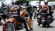 Members of the Hells Angels ride outside the Hells Angels Nomads compound during the group's Canada Run event in Carlsbad Springs, Ont., near Ottawa, on Saturday, July 23, 2016. (Justin Tang/The Canadian Press)