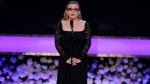 Carrie Fisher presents the life achievement award on stage at the 21st annual Screen Actors Guild Awards at the Shrine Auditorium on Sunday, Jan. 25, 2015, in Los Angeles. (Photo by Vince Bucci/Invision/AP)