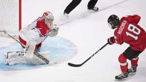 Switzerland's Nico Hischier (18) scores on Czech Republic's goaltender Jakub Skarek during the overtime period in a preliminary round of the IIHF World Junior Championship hockey action in Montreal, Tuesday, December 27, 2016. (Graham Hughes/The Canadian Press)