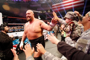 In this Dec. 11, 2011 photo, Big Show thanks the troops for their service during WWE's 9th annual 'Tribute To The Troops' holiday special at Crown Coliseum in Fayetteville, N.C. (AP / WWE / Jim R. Bounds)