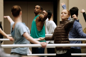 """Winnipeg Blue Bombers football player Maurice Leggett (centre) participates in a ballet class with the Royal Winnipeg Ballet at the Centennial Concert Hall in Winnipeg Monday, December 26, 2016. Leggett is among 16 people selected for walk-on roles this year in the ballet company's annual holiday show """"The Nutcracker"""". (THE CANADIAN PRESS/John Woods)"""