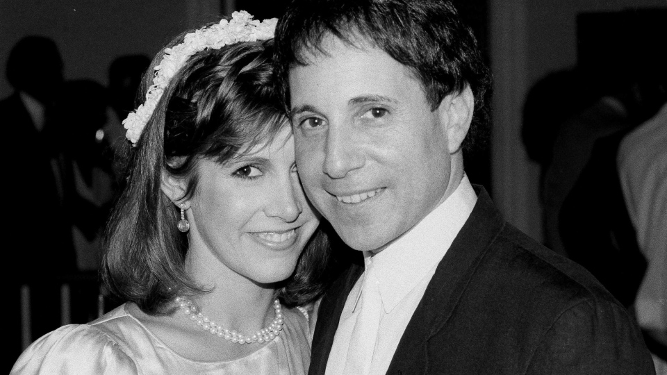 Carrie Fisher and Paul Simon during their wedding reception in New York on Aug. 16, 1983. (Mario Suriani / AP)