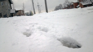 Footprints are seen on a snowy street in Kitchener in this file photo from December 2016. (Dan Lauckner / CTV Kitchener)