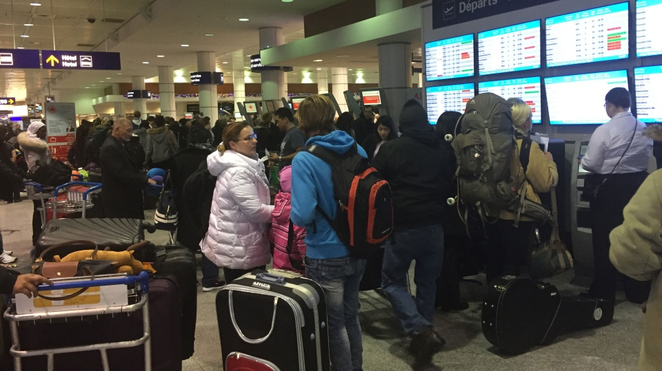 A busy scene at Trudeau Airport as Thursday's snowstorm has caused numerous cancellations and delays.