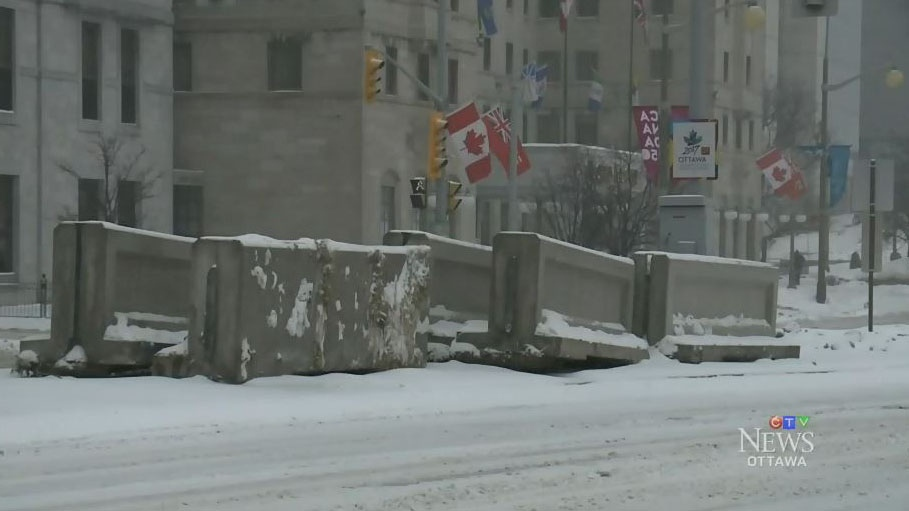 Concrete barriers that will be deployed as a terrorism-prevention measure collect snow in Ottawa, on Friday, Dec., 29, 2016.