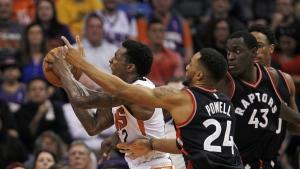 Toronto Raptors guard Norman Powell (24) and forward Pascal Siakam (43) pressure Phoenix Suns guard Eric Bledsoe (2) during the first half of an NBA basketball game, Thursday, Dec. 29, 2016, in Phoenix. The Suns won 99-91. (AP / Ricardo Arduengo)