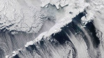 Clouds over the Aleutian Islands in an image captured by the MODIS on NASA's Aqua satellite on March 14, 2010. (NASA / AP)