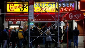 People wait in line to eat at the Carnegie Deli in New York, on Dec. 29, 2016. (Seth Wenig / THE ASSOCIATED PRESS)