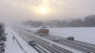 Vehicles drive through a snow squall on Highway 400 in Barrie, Ont. on Friday, Dec. 30, 2016. (Chris Garry/ CTV Barrie)
