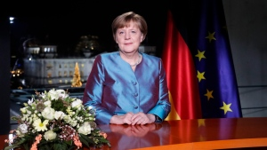 German Chancellor Angela Merkel poses for photographs after the television recording of her annual New Year's speech at the chancellery in Berlin, on Friday, Dec. 30, 2016. (AP Photo/Markus Schreiber)