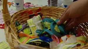 A basket of knitted handwarmers is seen at Montreal's Hope and Cope Wellness Centre for cancer patients.