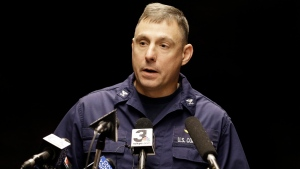 Capt. Michael Mullen of the U.S. Coast Guard answers questions during a news conference at Burke Lakefront Airport, Friday, Dec. 30, 2016, in Cleveland. (AP Photo / Tony Dejak)