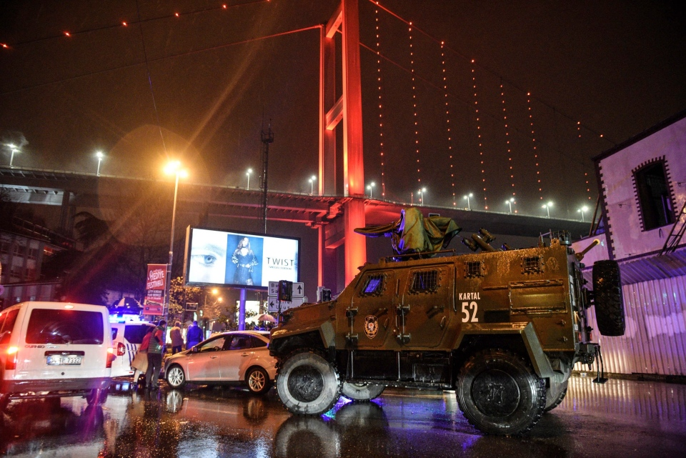 A police armoured vehicle blocks the road leading to the scene of an attack in Istanbul, early Sunday, Jan. 1, 2017. (AP Photo)