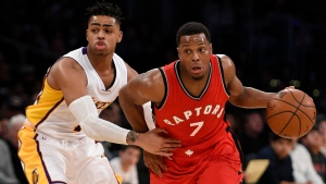 Toronto Raptors guard Kyle Lowry, right, drives the ball past Los Angeles Lakers guard D'Angelo Russell during the first half of an NBA basketball game in Los Angeles, Sunday, Jan. 1, 2017. (AP / Kelvin Kuo)
