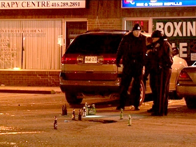Police at the scene of a Saturday, Feb. 28, 2009 shooting in a plaza at the intersection of Kennedy Road and Lawrence Avenue East.