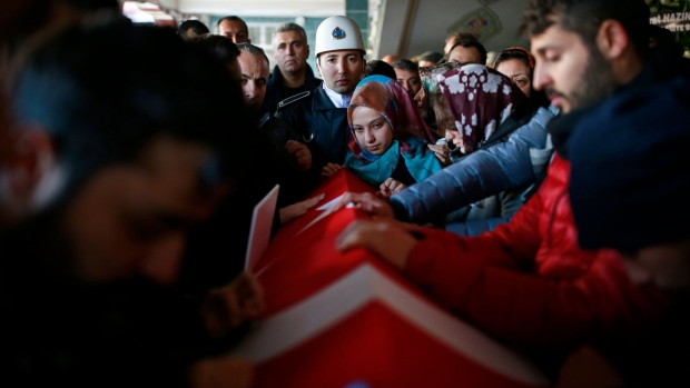 Mourners gather around the Turkish flag-draped coffin of Yunus Gormek, 23, one of the victims of the attack at a nightclub on New Year's Day, during the funeral in Istanbul, Monday, Jan. 2, 2017. (AP / Emrah Gurel)