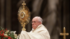 Pope Francis holds a monstrance as he celebrates a new year's eve vespers Mass in St. Peter's Basilica at the Vatican, on Dec. 31, 2016. (Andrew Medichini / AP)