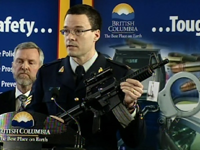 RCMP Sgt. Tim Shields demonstrates the severity of the B.C. gun problem in this image taken from video.