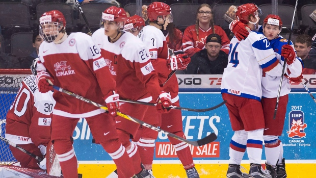 Russia forward Kirill Kaprizov (right) celebrates his goal with teammate  Mikhail Vorobyov as Denmark players look on during first period IIHF World  Junior ... 4161c409bb8