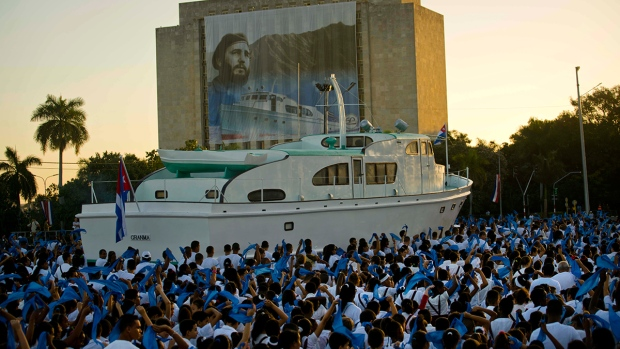 Students attend a military parade in honor of late Cuban leader Fidel Castro alongside a reproduction of the yacht Granma through Revolution Square in Havana, Cuba, Monday, Jan. 2, 2017. (AP / Ramon Espinosa)