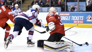 United States forward Jordan Greenway (12) scores against Switzerland goaltender Joren van Pottelberghe (30) as defenceman Yanik Burren (2) defends during third period quarter-final IIHF World Junior Championship hockey action in Toronto, Monday, January 2, 2017. THE CANADIAN PRESS/Frank Gunn