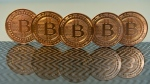 This June 17, 2014 photo taken in Washington, D.C. shows bitcoin medals. © AFP / Karen BLEIER
