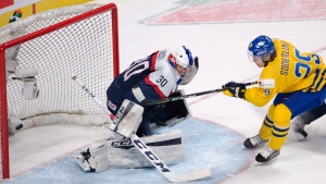 Sweden's Tim Soderlund (29) scores his team's second goal against Slovakia goaltender Adam Huska (30) during first period IIHF World Junior Championships quarterfinal hockey action, Monday, January 2, 2017 in Montreal. (Ryan Remiorz/The Canadian Press)