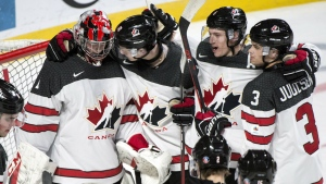 Players gather around Canada goaltender Connor Ingram to celebrate their 5-3 victory over Czech Republic in quarter-final hockey action at IIHF World Junior Championship Monday, January 2, 2017 in Montreal. THE CANADIAN PRESS/Paul Chiasson