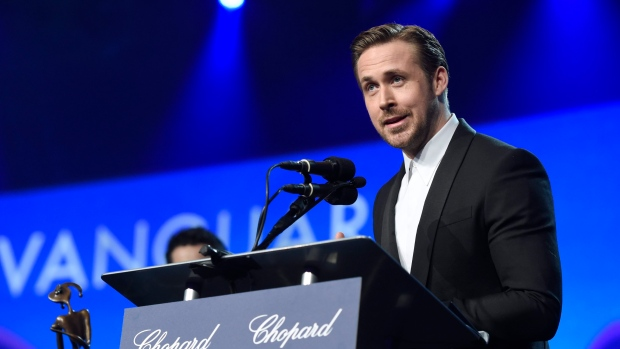 Ryan Gosling accepts the Vanguard award for 'La La Land' at the 28th annual Palm Springs International Film Festival Awards Gala in Palm Springs, Calif. ON on Monday, Jan. 2, 2017. (Chris Pizzello / Invision)
