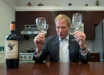 In this Tuesday, Dec. 6, 2016 photo, Brian Wansink, a food behaviour scientist at Cornell University, holds wine glasses during a demonstration in a food lab at the university in Ithaca, N.Y. (AP Photo/Mike Groll)