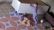 Toddler pushes dresser off brother