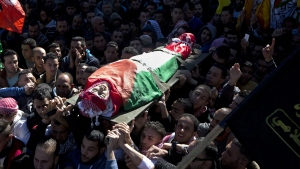 File - In this Tuesday, Dec. 8, 2015 file photo, Palestinian mourners carry the body of Malik Shaheen, 21, who was killed in clashes with Israeli troops, during his funeral in Deheishe refugee camp near the West Bank city of Bethlehem. (AP Photo/Majdi Mohammed, File)
