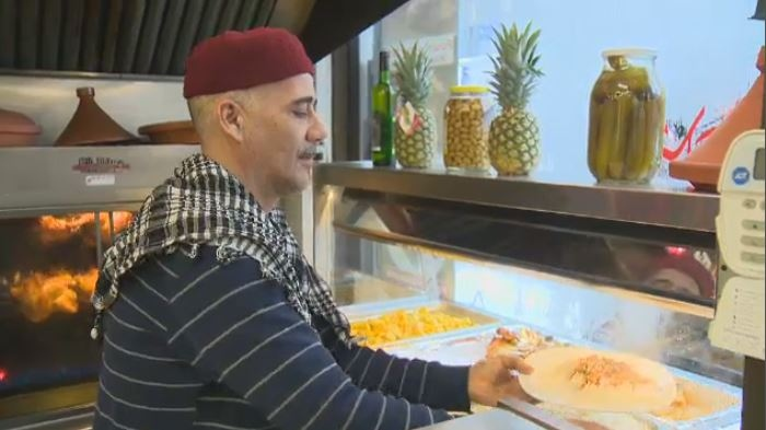 Chef Abdelkader Bejaoui serves up a hot meal at Marche Restaurant Ferdous.