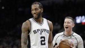 San Antonio Spurs forward Kawhi Leonard (2) and referee Nick Buchert (3) share a laugh during the first half of an NBA basketball game against the Toronto Raptors, Tuesday, Jan. 3, 2017, in San Antonio. (AP / Eric Gay)