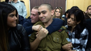 Israeli solider Sgt. Elor Azaria with his parents inside the military court in Tel Aviv, Israel on Jan. 4, 2017. (Heidi Levine / Pool via AP)