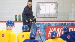 Team Sweden's head coach Tomas Monten goes over a play on Jan. 3, 2017 in Brossard, Quebec. (Ryan Remiorz / THE CANADIAN PRESS)