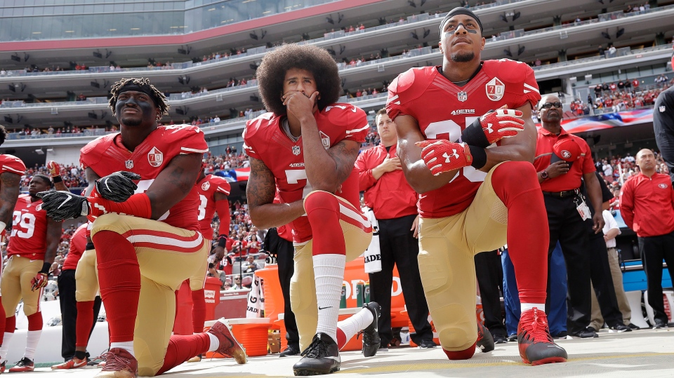 San Francisco 49ers outside linebacker Eli Harold, quarterback Colin Kaepernick and safety Eric Reid kneel during the national anthem before an NFL football game against the Dallas Cowboys in Santa Clara, Calif. on Oct. 2, 2016. (Marcio Jose Sanchez/AP)