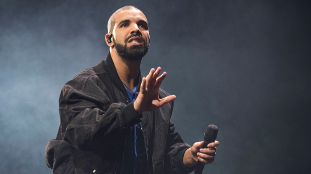 FILE - In this Oct. 8, 2016 file photo, Drake performs onstage in Toronto. (Photo by Arthur Mola/Invision/AP, File)
