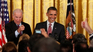President Barack Obama, right, and Vice President Joe Biden react to the audience as they participate in a LGBT Pride Month event at the White House in Washington on June 22, 2010. (Carolyn Kaster/AP)