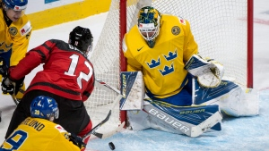 Canada's Julien Gauthier scores on Sweden goaltender Felix Sandstrom during second period IIHF World Junior Championship semifinals hockey action Wednesday, January 4, 2017 in Montreal. (Paul Chiasson/The Canadian Press)