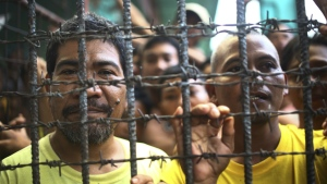 Filipino inmates remain in their cell at the North Cotabato District Jail in Kidapawan city, Cotabato Province, southern Philippines, after a massive jailbreak on Wednesday, Jan. 4, 2017. (AP)