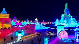 Visitors tour a castle-like structures made from blocks of ice at the Harbin International Ice and Snow festival in Harbin, northeastern's China's Heilongjiang province. (Helene Franchineau/AP)
