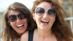 Gillian Mandich said happier people smile more often, even when they're not feeling very positive.